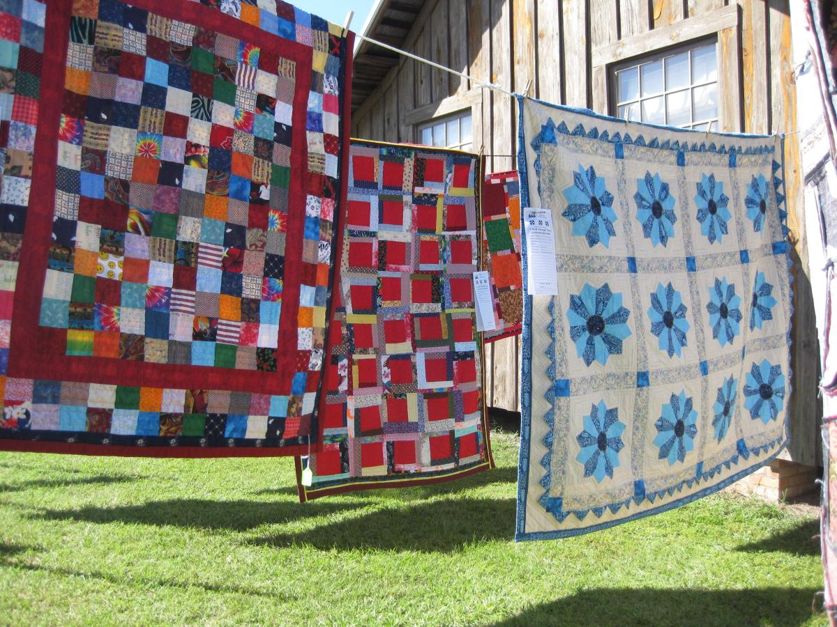 Quilts hanging outside